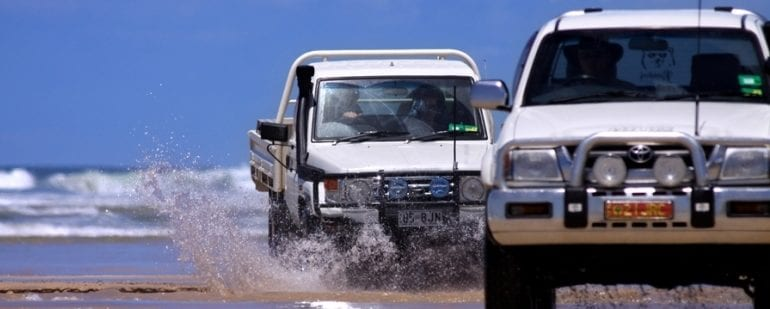 Image of a 4WD car driving in the sand